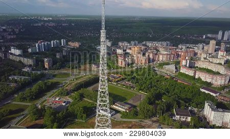 Aerial Of The Tv Tower At Autumn. Top View Of The Tv Tower In The City.