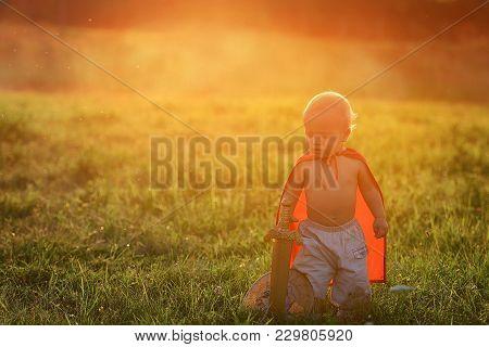Little Prince Kid In Costume Hero. Small Boy King Outdoors Sunset Ray Light Summer. Cute Caucasian B