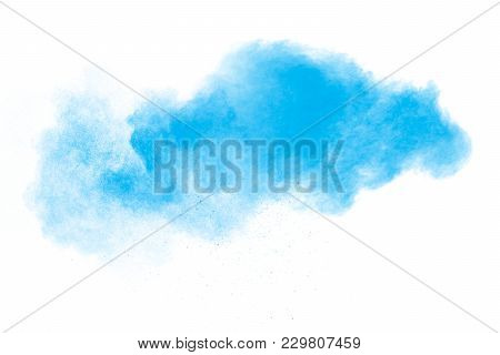 Blue Color Powder Explosion Cloud Isolated On White Background.closeup Of Blue Dust Particles Splash