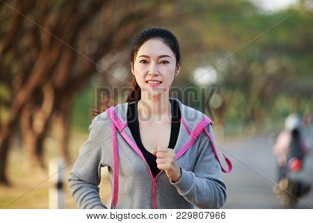 Fitness Woman Running In Park