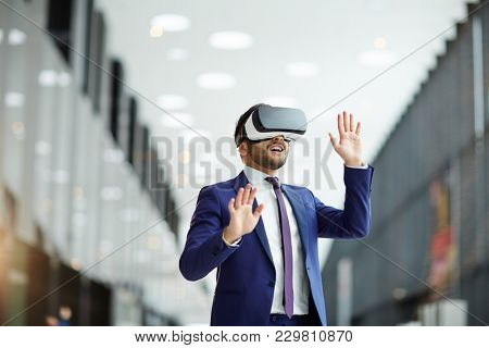 Happy young politics or businessman with vr headset expressing awe while watching conference