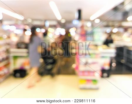 Blurred Customer Walking To Checkout Counter At Supermarket