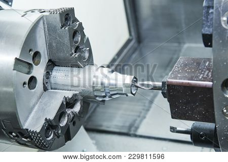 metalworking drilling process on lathe CNC center