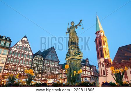 Scales Of Justice At Romerberg Square, The Old Town Center, And The Romer, With The Old Nikolai Chur