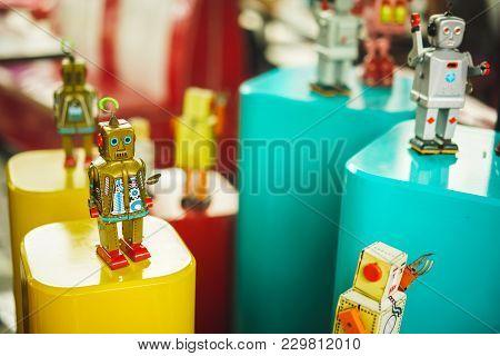 Group Of Vintage Toys Robot Old Color. Old Vintage Golden Robot Toy On A Pedestal. Robotics And Desi