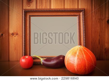 Fresh Vegetables And Picture Frame On Wooden Background