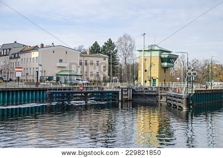 Spandau Locks On The River Havel Near The Old Town Of Spandau With Its Gate And Building, Connecting