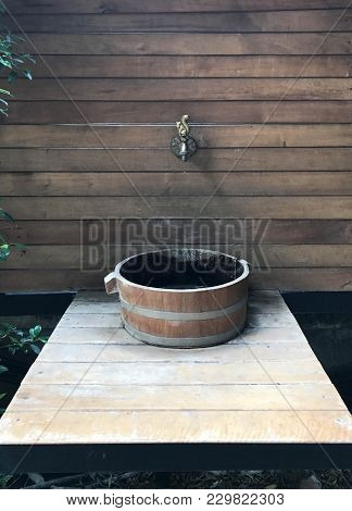 Classic Wooden Wash Basin With Brass Faucet On Wooden Wall, Hygiene And Interior Concept