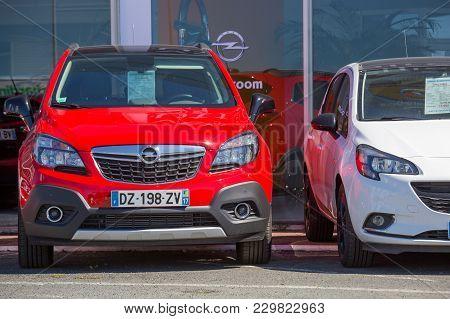 Two Red Kia Motors Cars Outside Showroom