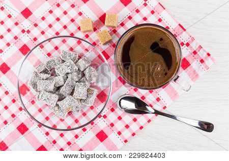 Turkish Delight In Saucer, Black Coffee In Cup, Sugar Cubes And Spoon On Checkered Napkin On Wooden