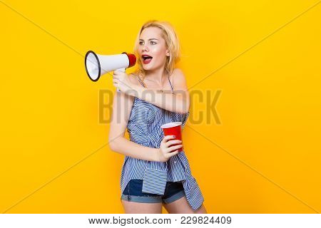 Woman With Red Lips In Blue Striped Shirt And Jeans Shorts On Yellow Background With Copyspace Hold