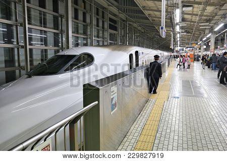 Kyoto, Japan - November 28, 2016: Passengers Board Shinkansen Train In Kyoto Station, Japan. Shinkan