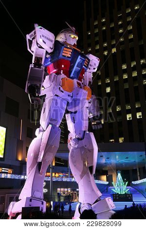 Tokyo, Japan - December 2, 2016: People Visit Mobile Suit Gundam Gigantic Robot Statue In Odaiba, To