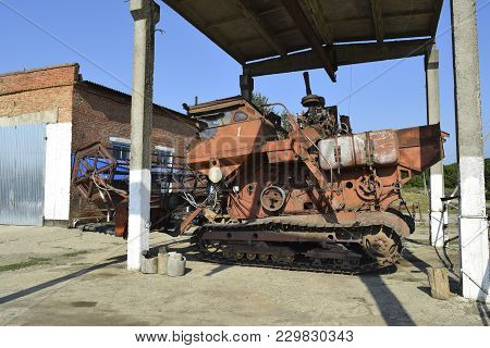 Russia, Poltavskaya Village - September 6 2015: Old Rusty Disassembled Combine Harvester. Combine Ha