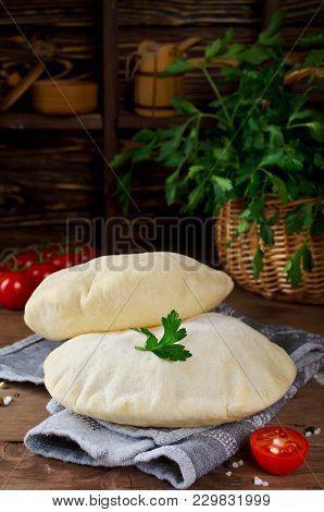 Homemade Whole Pita - Baked Israeli Flat Bread. Pita Bread On A Wooden Background