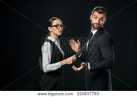 Businesspeople Holding Knife And Quarreling Isolated On Black