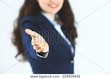 Beautiful Young Smiling Business Woman, Happy And Smiling , With An Open Hand Ready To Seal A Deal O