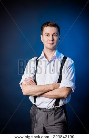 Man In The White Shirt, Suspenders And Trousers. Clothing American Guy Of The Fifties.