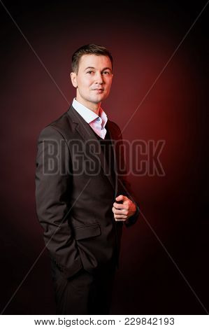 Business Man In A Classic Suit In A Photo Studio