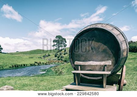 Wine Barrel In Green Grass Field In Vintage Tone