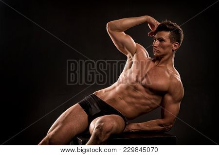 Man Show Muscular Torso, Body, Muscles. Bodybuilder Flex Arm With Biceps, Triceps. Athlete With Six