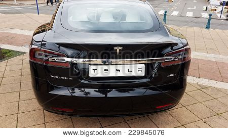 Menton, France - March 3, 2018: Black Tesla Model S (rear View) Electric Car Parked On A Square In M
