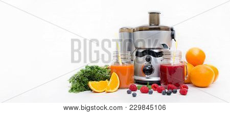 Preparing Juice From Fresh Fruits And Vegetables. Electric Juicer, Healthy Lifestyle Concept