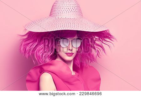 Fashion Portrait Girl With Pink Hair In Hat, Trendy Sunglasses. Young Woman In Stylish Outfit. Glamo