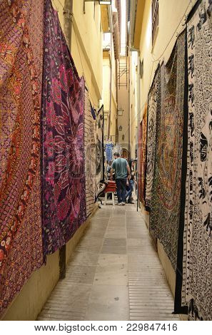 Granada, Spain - May 21, 2017: Carpets On Wall Of  Narrow Street At The Handicraft Market  In The Ci