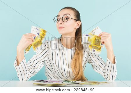 Portrait Of Attractive Happy Woman In Striped Shirt And Eyeglasses Isolated On Blue Background Holdi
