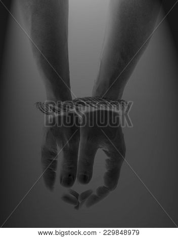 Male Hands Bound With Rope On Black.addiction Concept.