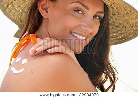 Woman using suncream