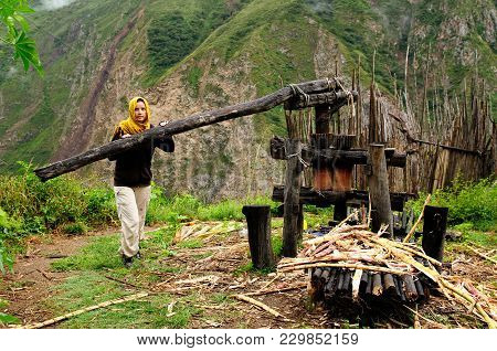 Tourist On The Trekking To Choquequirao Ruins Standing By The Elder Machine For The Extrusion Of The