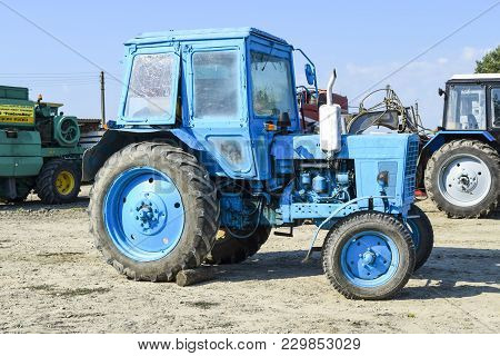 Russia, Temryuk - 15 July 2015: Tractor. Agricultural Machinery Tractor. Parking Of Tractor Agricult