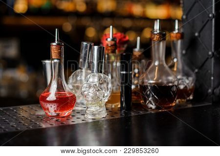 Beautiful Unusual Little Bottles Of Spirits And Liquor Standing At The Steel Grey Bar Counter