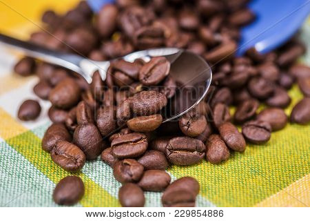 Closeup Of Coffee Beans On A Colourful Background
