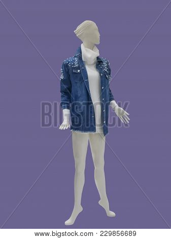 Full-length Female Mannequin Dressed In Jeans Jacket And Sweater, Isolated. No Brand Names Or Copyri
