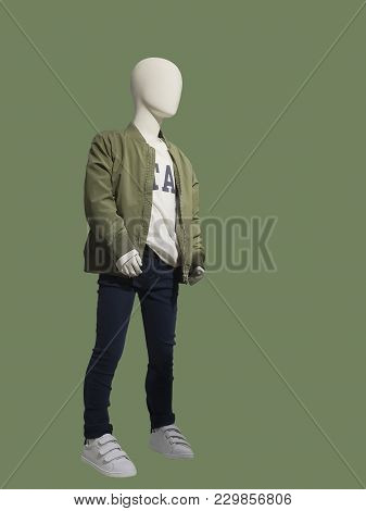 Child Mannequin Dressed In Fashionable Kids Wear, Isolated. No Brand Names Or Copyright Objects.