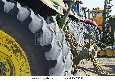 Russia, Temryuk - 15 July 2015: Tractor. Agricultural Machinery Tractor. Rear Wheels Of The Tractor.