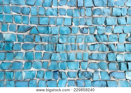 Turquoise Color Smalt On Gray Cement Wall.
