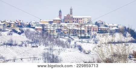 Winter Panoramic View Of The Hilly Region Of Langhe (in The Southern Area Of Piemonte Region, Northe
