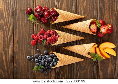 Fresh Fruit And Berries In Waffle Cones, Healthy Summer Food Concept