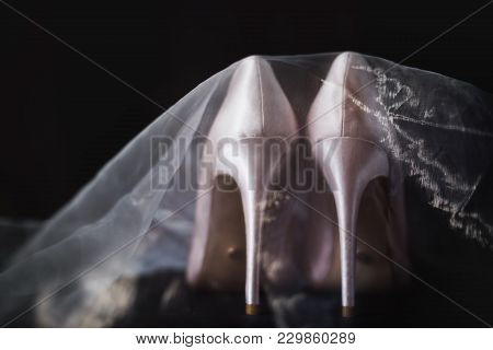 Beige Bridal Shoes Are Veiled. Wedding Accessories
