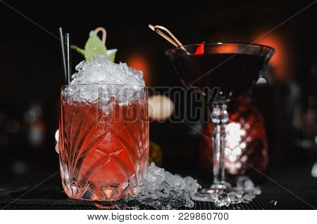 Two Alcohol Different Cocktails On The Bar
