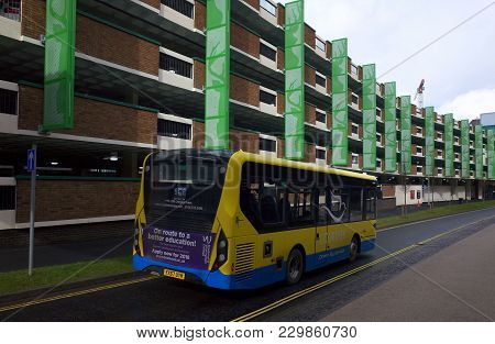 Bracknell, England - March 04, 2018:a Local Transport Bus Owned By The Courtney Company Drives By On