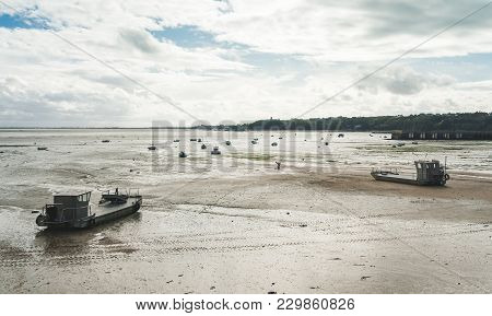 View Of Multiple Boats And Yachts On Sea Floor At Low Tide In Cancale, Brittany, France
