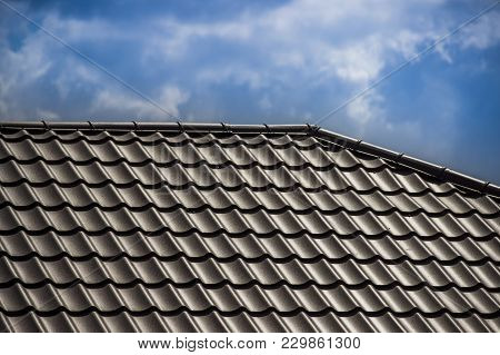 The Brown Tiles Roof On The Top Of House
