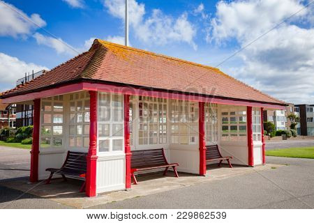 Victorian wooden sea front shelter and seating at popular seaside resort Bexhill-on-Sea in East Sussex South East England UK