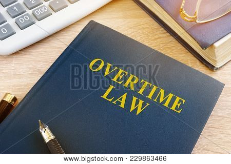 Overtime Law And Calculator In An Office.