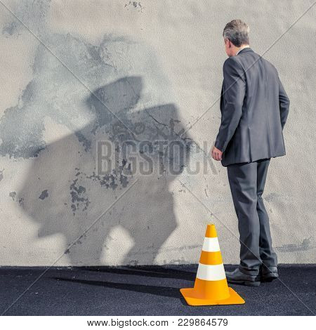 3d illustration of a business man facing a dirty wall